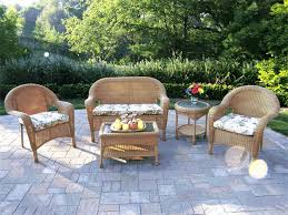 exterior wicker armchairs which paired with glass rectangular