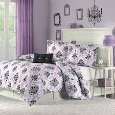luxury bedroom with black white purple damask bedding wall