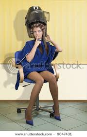 sissy boys hair dryers stock photo young woman sitting under a hairdryer with roller on