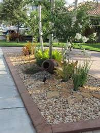 Colored Rocks For Garden Creative Planting Areas Between A Sidewalk And Can
