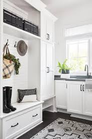 white kitchen cupboards black bench black and white mudroom with built in cabinets