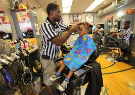 hundreds of milwaukee boys line up for free back to haircuts