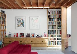 designer garages architect architecture clipgoo 6 garages converted into useful living spaces dwell family room with hinged tall door and bookcases