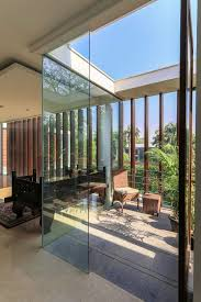 wooden slats glass walls and modern grandeur gallery house in india