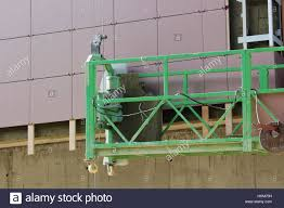 work with green front two suspended cradle without workers on a