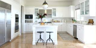 tv in kitchen ideas cabinet design ideas bright white cabinetry bounces light and makes