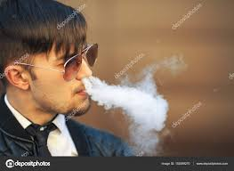 urban haircut for white men vape man portrait of a handsome young white guy with modern