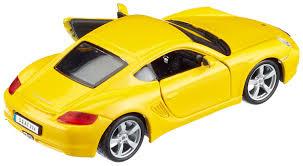 porsche cayman yellow bburago 1 32 street fire porsche cayman s amazon co uk toys u0026 games
