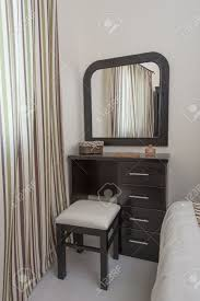modern black dressing table dressing table with stool and mirror in a bedroom stock photo