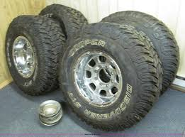 mudding tires 4 aluminum wheels and mud tires item e2002 sold wedne