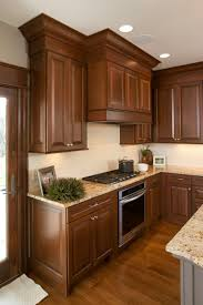 brown stained kitchen cabinets view this welcoming kitchen showplace cabinetry