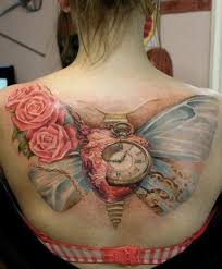 picture of clock and butterfly wings on the back