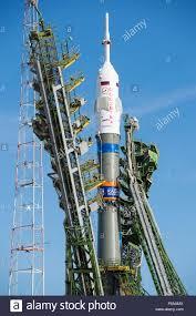 the gantry arms close around the soyuz tma 14m spacecraft to