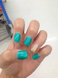 love the blue color i could go without the gold nail nail