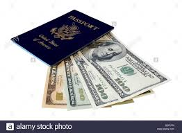 us passport and us dollars on white background stock photo