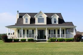 farmhouse with wrap around porch wrap around porch quality hardscapes porch masters