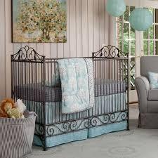 bedroom astonishing black wrought iron crib with gray sofa chair