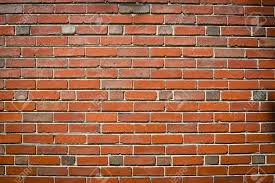 urban background dark red brick wall texture stock photo