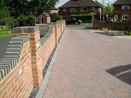 grey brick at top of wall to match windows and garage door
