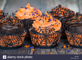 chocolate halloween cakes orange and dark chocolate halloween cupcakes against rustic stock