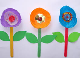 flowers made with cupcake liners buttons popsicle sticks