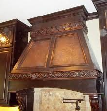 kitchen brass vent hoods with tile back splash also wood kitchen