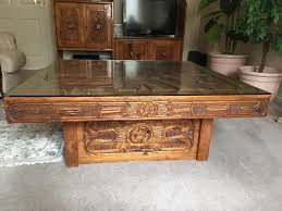 hand carved solid wood coffee table with glass top in slough