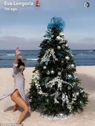 longoria places tree on the sand while celebrating