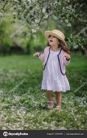 cute smiling dressy baby on walk in blooming