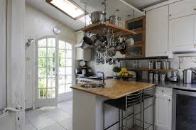 traditional white french kitchen with sophisticated stainless