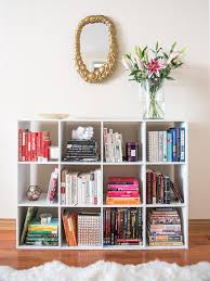 entryway bookcase how to style a bookshelf with wayfair visions of vogue