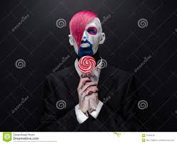 black scary halloween background clown and halloween theme scary clown with pink hair in a black