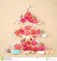 beach xmas concept on sand as a christmas tree with shells and f