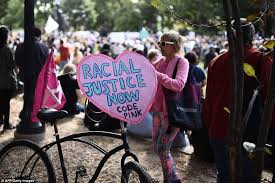 Black Purple Pink Green Peace by Two Marches For Racial Justice Converge In Washington Dc Daily