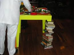 cool idea stacked books table leg popsugar home
