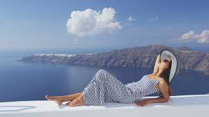 Minnesota is it safe to travel to greece images Travel vacation woman looking at view on santorini famous europe