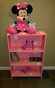 a broken thrift bookcase redone into pink w white polka dots