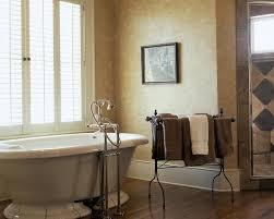 wrought iron bathroom mediterranean with light beige flooring