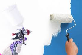 can you use a paint sprayer to paint kitchen cabinets spraying vs rolling paint which is the best method bob vila