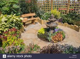 garden with seating area designed for a small space stock photo
