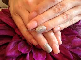 acrylic nails with pink whisper gel polish and silver glitter gel