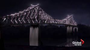a sneak peek as jacques cartier bridge lights up for montreal s