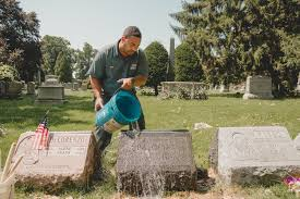 headstone pictures remembering jean michel basquiat and scrubbing grime from his