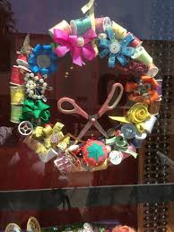 a wreath for someone who loves to sew it was on display in a