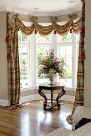 How To Put Curtains On Bay Windows Curtains For Bay Windows When Youre On A Budget Window Design