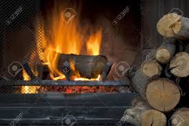 fire in fireplace with a pile of log firewood stock photo picture
