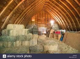 inside an old hip roof barn on the prairies of saskatchewan stock