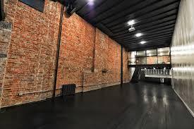 a creative loft studio space featuring warm red brick walls black