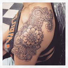 lovely small paisley pattern tattoo on upper back