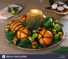 oranges and limes studded with cloves fir sprigs u0026 candle stock